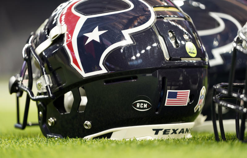 A former Houston Texans security employee alleges he and others were fired by now-former GM Brian Gaine because of their race. (AP)
