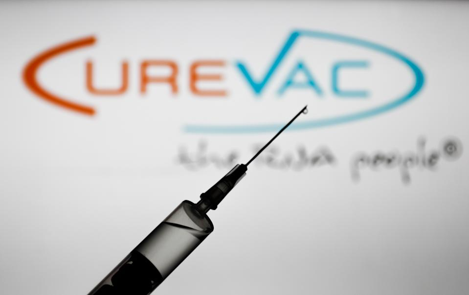 Medical syringe is seen with Curevac company logo displayed on a screen in the background in this illustration photo taken in Poland on November 16, 2020. (Photo by Jakub Porzycki/NurPhoto via Getty Images)