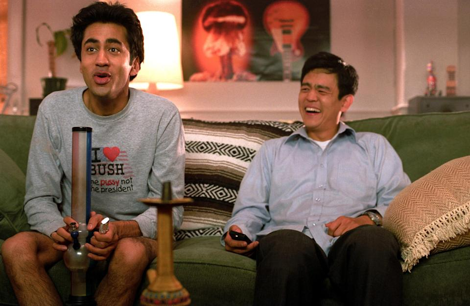 Harold and Kumar smoking on the couch
