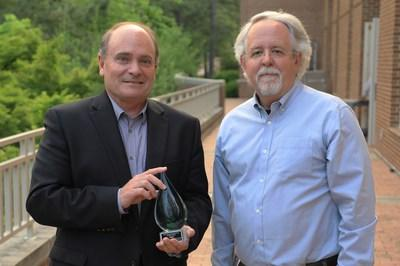 Kevin Hall, Unifi CEO receives 2018 UNC Sustainability Award from Albert Segars, PNC Distinguished Professor, Strategy & Entrepreneurship and Faculty Director, Center for Sustainable Enterprise.