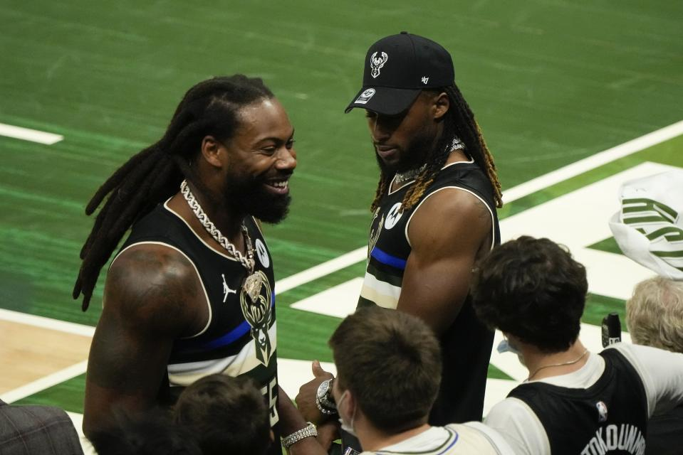 Green Bay Packers Za'Darius Smith and Aaron Jones have some fun during the second half of Game 3 of the NBA Eastern Conference basketball semifinals game between the Milwaukee Bucks and the Brooklyn NetsThursday, June 10, 2021, in Milwaukee. The Bucks won 86-83 and the Nets lead the series 2-1. (AP Photo/Morry Gash)