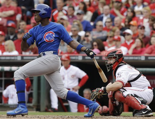Chicago Cubs' Alfonso Soriano, left, gets a hit off Cincinnati Reds starting pitcher Homer Bailey to drive in a run in the third inning of a baseball game on Saturday, May 25, 2013, in Cincinnati. Reds catcher Ryan Hanigan, right, looks on. (AP Photo/Al Behrman)
