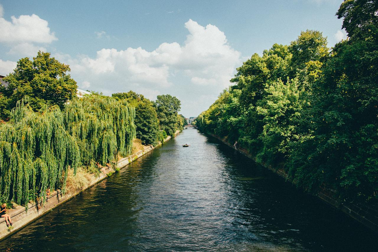 """<p><strong>Let's start big picture. What's the vibe here?</strong><br> You visit the <a href=""""https://www.cntraveler.com/activities/berlin/brandenburg-gate?mbid=synd_yahoo_rss"""">Brandenburg Gate</a> and <a href=""""https://www.cntraveler.com/activities/berlin/reichstag-building?mbid=synd_yahoo_rss"""">Reichstag</a> to sightsee in Berlin. You wander the Landwehr Canal to feel the true rhythm of city—and then fall in love with it. Arguably Berlin's best people-watching spot, the canal unites two of the city's hippest 'hoods (Kreuzberg and Neukölln, called """"Kreuzkölln"""") into the beating heart of the bohemian counterculture scene. In fact, one of the most quintessential Berlin experiences you can have is grabbing a €1 ($1.13) beer from a spätkauf (Berlin's version of a bodega) and sitting along the canal's grassy banks under a weeping willow tree. You'll be surrounded by scruffy hipsters, Turkish families, hard-nosed Berliners, and everyone in between.</p> <p><strong>Any standout features or must-sees?</strong><br> On warm days and weekends, Admiralbrücke transforms into something of an outdoor circus, with street performers, picnickers, and sightseers congregating on the cobblestone bridge. A few steps west, follow the stately balconies and pre-war buildings along Planuferstrasse (one of Berlin's most photogenic streets) toward splashing swans and sun-bathing paddlers rowing by the Urbanhafen park. To the east of Admiralbrücke, don't miss Paul-Lincke-Ufer street, with its mix of Michelin-starred restaurants (<a href=""""https://www.cntraveler.com/restaurants/berlin/horvath?mbid=synd_yahoo_rss"""">Horvath</a>) and legendary vinyl shops (Hard Wax).</p> <p><strong>Was it easy to get around?</strong> A well-marked footpath runs along the canal through much of Berlin. In addition, benches, biergartens, bocce courts, and other welcome distractions invite you to sit and linger.</p> <p><strong>All said and done, what—and who—is this best for?</strong><br> If you're short on time, head to e"""
