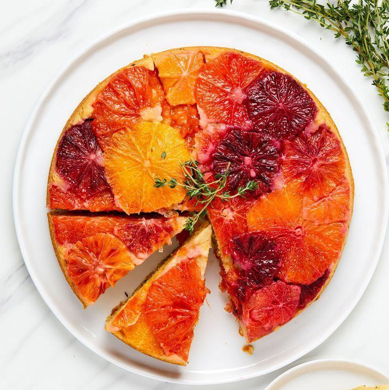"""<p> There's nothing extra complicated about this cake, but the little extra effort of slicing citrus and fanning them out in the bottom of the cake pans results in a something so very beautiful.</p><p>Get the <a href=""""https://www.delish.com/uk/cooking/recipes/a35848520/citrus-upside-down-cake-recipe/"""" rel=""""nofollow noopener"""" target=""""_blank"""" data-ylk=""""slk:Citrus Upside-Down Cake"""" class=""""link rapid-noclick-resp"""">Citrus Upside-Down Cake</a> recipe. </p>"""