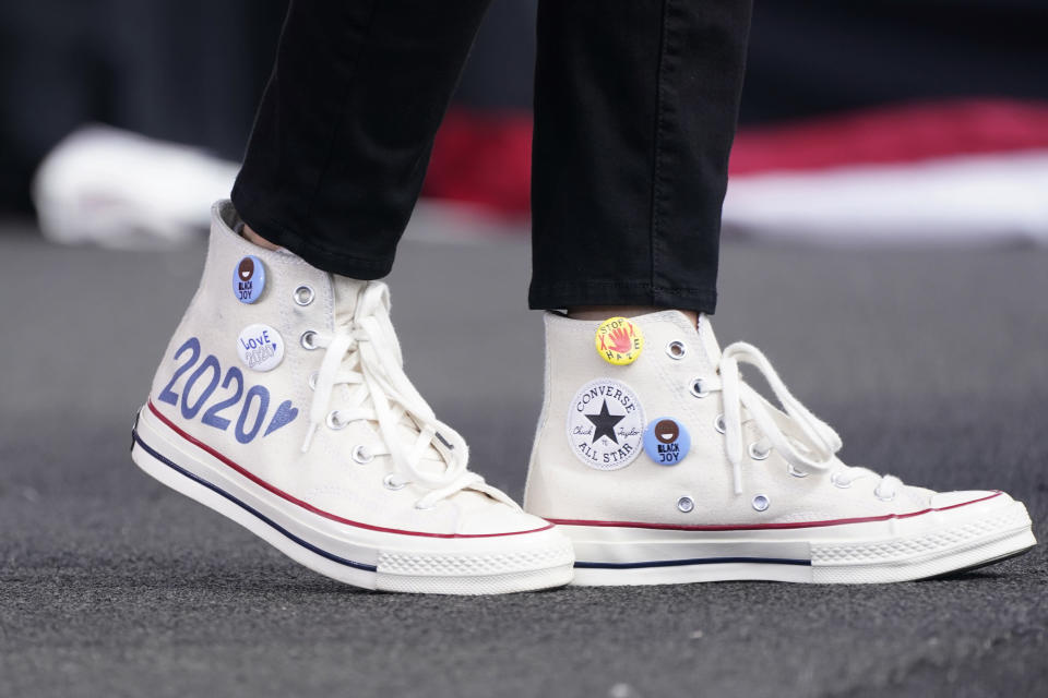 Democratic vice presidential candidate Sen. Kamala Harris, D-Calif., wears Converse high-top sneakers while she speaks at a drive-in early voting event, Saturday, Oct. 31, 2020, in Miami, Fla. (AP Photo/Wilfredo Lee)