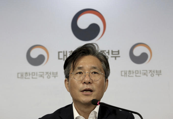 Sung Yun-mo, South Korea's minister of Trade, Industry and Energy, speaks during a press conference at the government complex in Seoul, South Korea, Monday, Aug. 5, 2019. Sung said South Korea will spend 7.8 trillion won ($6.5 billion) over the next seven years to develop technologies for industrial materials and parts as it moves to reduce its dependence on Japan during an escalating trade row. The announcement came days after Japan's Cabinet approved the removal of South Korea from a list of countries with preferential trade status. (AP Photo/Ahn Young-joon)