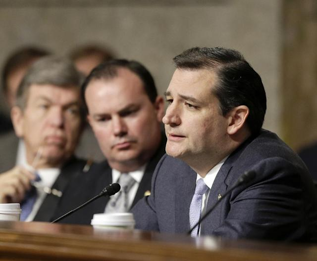 FILE - In this Jan. 31, 2013 file photo Armed Services committee member, Republican Sen. Ted Cruz of Texas, questions former Sen. Chuck Hagel (not shown), President Obama's choice for defense secretary, during Hagel's confirmation hearing on Capitol Hill in Washington. Weeks into his job, Texas Republicans are cheering Cruz's indelicate debut and embracing him as one of their own. The insurgent Republican elected with the tea party's blessing and bankroll, has run afoul of GOP mainstays, and prompted Democrats to compare his style to McCarthyism. Also seen from left are Sen.s Roy Blunt, R-Mo., and Mike Lee, R-Utah. (AP Photo/J. Scott Applewhite, File)