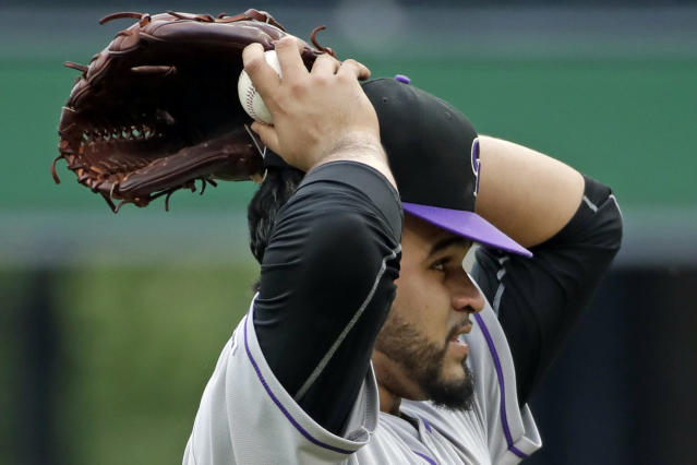 Colorado Rockies starting pitcher Antonio Senzatela collects himself after giving up an RBI double to Pittsburgh Pirates' Melky Cabrera in the first inning of a baseball game in Pittsburgh, Thursday, May 23, 2019. (AP Photo/Gene J. Puskar)