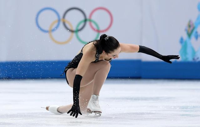 SOCHI, RUSSIA - FEBRUARY 19: Kaetlyn Osmond of Canada falls while competing in the Figure Skating Ladies' Short Program on day 12 of the Sochi 2014 Winter Olympics at Iceberg Skating Palace on February 19, 2014 in Sochi, Russia. (Photo by Matthew Stockman/Getty Images)