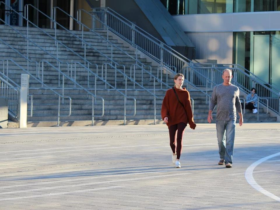 Two people walk through Lansdowne Park in Ottawa on Oct. 7, 2021.  (Sara Frizzell/CBC - image credit)