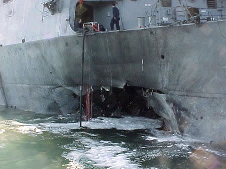 File photo of damaged guided missile destroyer USS Cole after bomb attack in the port of Aden