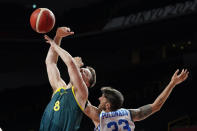 Australia's Matthew Dellavedova (8) is fouled by Italy's Achille Polonara, right, during a men's basketball preliminary round game at the 2020 Summer Olympics, Wednesday, July 28, 2021, in Saitama, Japan. (AP Photo/Charlie Neibergall)