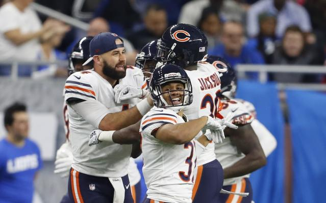 Chicago Bears quarterback Chase Daniel, left, congratulates free safety Eddie Jackson (39) after Jackson returned an interception 41-yards for a touchdown during the second half of an NFL football game against the Detroit Lions, Thursday, Nov. 22, 2018, in Detroit. (AP Photo/Paul Sancya)