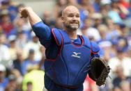 FILE - In this July 24, 2016, file photo, Chicago Cubs' David Ross throws out a Milwaukee Brewers batter during a baseball game in Milwaukee. Former Cubs catchers Joe Girardi and Ross will speak with the team next week about its managerial opening. The team also plans to interview first base coach Will Venable next week. Bench coach Mark Loretta interviewed for the job Thursday. The Cubs are searching for a successor to Joe Maddon, whose contract expired after the Cubs missed the playoffs this year for the first time since 2014. (AP Photo/Benny Sieu, File)