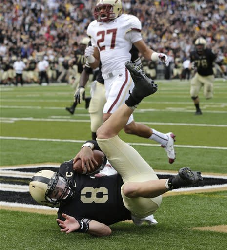 Army quarterback Trent Steelman (8) scores the game-winning touchdown in front of Boston College defender Justin Simmons (27) during the second half of an NCAA college football game Saturday, Oct. 6, 2012, in West Point, N.Y. Army won, 34-31. (AP Photo/Mike Groll)