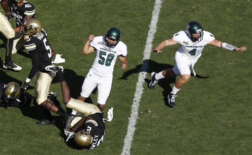 Sacramento State place kicker Edgar Castaneda, third from left, celebrates making the winning field goal with holder Mason Magleby, far right, as Colorado special teams players Yuri Wright, far left, and Keneth Crawley watch in the fourth quarter of their NCAA college football game in Boulder, Colo., Saturday, Sept. 8, 2012. Sacramento State won 30-28. (AP Photo/David Zalubowski)