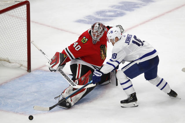 Chicago Blackhawks' Robin Lehner, left, makes a save on Toronto Maple Leafs' Andreas Johnsson during the second period of an NHL hockey game Sunday, Nov. 10, 2019, in Chicago. (AP Photo/Jim Young)