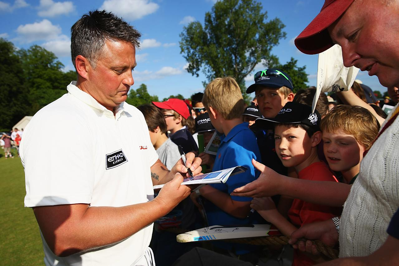 CIRENCESTER, ENGLAND - JUNE 09:  Darren Gough of Michael Vaughan's England signs autographs after the Shane Warne's Australia vs Michael Vaughan's England T20 match at Circenster Cricket Club on June 9, 2013 in Cirencester, England.  (Photo by Matthew Lewis/Getty Images)
