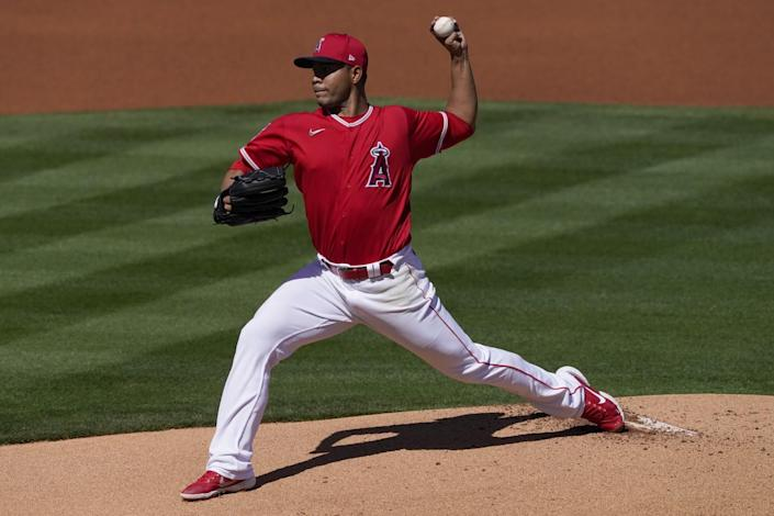 Los Angeles Angels starting pitcher Jose Quintana throws against the Colorado Rockies.