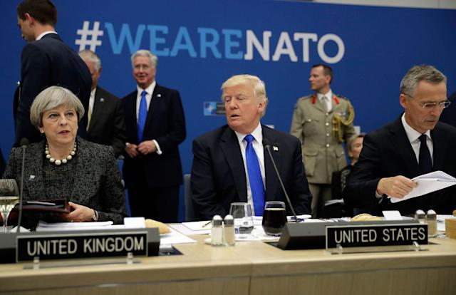 <p>President Donald Trump, center, is flanked by British Prime Minister Theresa May, left, and NATO Secretary General Jens Stoltenberg during in a working dinner meeting at the NATO headquarters during a NATO summit of heads of state and government in Brussels on Thursday, May 25, 2017. US President Donald Trump inaugurated the new headquarters during a ceremony on Thursday with other heads of state and government. (AP Photo/Matt Dunham, Pool) </p>