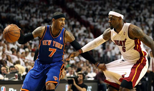 MIAMI, FL - APRIL 28: Forward Carmelo Anthony #7 (L) of the New York Knicks is defended by Forward LeBron James #6 of the Miami Heat in Game One of the Eastern Conference Quarterfinals in the 2012 NBA Playoffs on April 28, 2012 at the American Airines Arena in Miami, Florida. NOTE TO USER: User expressly acknowledges and agrees that, by downloading and or using this photograph, User is consenting to the terms and conditions of the Getty Images License Agreement. (Photo by Marc Serota/Getty Images)