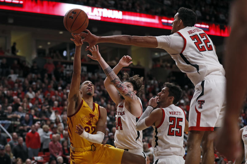 Texas Tech's Avery Benson (24) and TJ Holyfield (22) block a shot by Iowa State's Tyrese Haliburton (22) during the second half of an NCAA college basketball game Saturday, Jan. 18, 2020, in Lubbock, Texas. (AP Photo/Brad Tollefson)