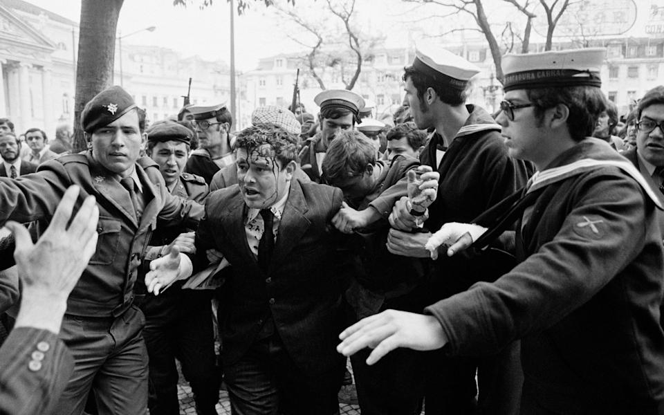 A man believed to be a government agent is escorted away by soldiers during the unrest following the Carnation Revolution - Henri Bureau/Sygma/Corbis/VCG via Getty Images