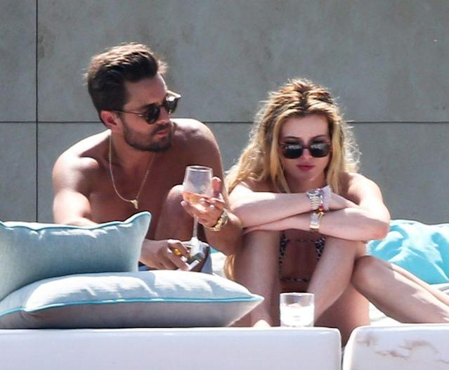 Scott Disick is seen with short-term gal pal Bella Thorne as they sunbathed at a luxury villa in Cannes, (Photo: Splash News)