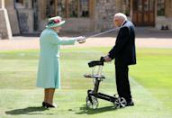 <p>The queen awards Captain Sir Thomas Moore with the insignia of Knight Bachelor at Windsor Castle. British World War II veteran Captain Tom Moore raised over $38 million for the NHS during the coronavirus pandemic. </p>