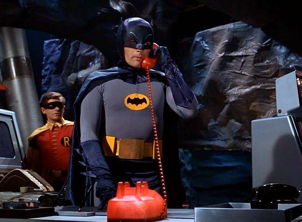Batman answers the Batphone in the 1966 series. (Photo: Warner Bros.)