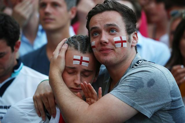<p>England fan looks dejected after the match. REUTERS/Simon Dawson </p>