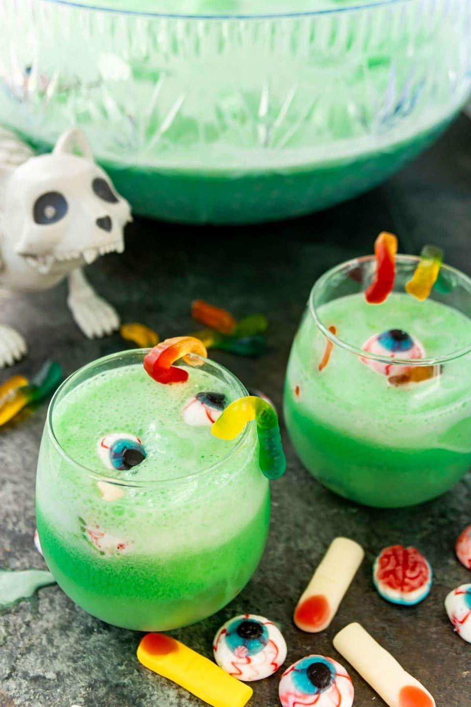 """<p> Combine 2 liters of lemon-lime soda and 64 oz. of lemonade in a large punch bowl. Then, add 1/2 cup of blue raspberry Kool-Aid powder and mix until combined. Add 1 3/4 quart of lime sherbert (don't mix in). Garnish with gummy worms, brains, and body parts for the full spooky effect. </p><p><em>Recipe from <a href=""""https://www.playpartyplan.com/halloween-punch/"""" rel=""""nofollow noopener"""" target=""""_blank"""" data-ylk=""""slk:Play Party Plan."""" class=""""link rapid-noclick-resp"""">Play Party Plan. </a></em></p>"""