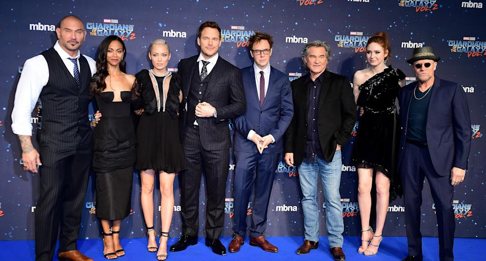 From left, Guardians<em> of the Galaxy Vol. 2</em> cast members Dave Bautista, Zoe Saldana, Pom Klementieff, Chris Pratt, James Gunn, Kurt Russell, Karen Gillan, and Michael Rooker. (Photo: Ian West/PA Images via Getty Images)