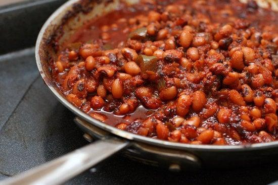 """<p>The <a href=""""https://www.popsugar.com/food/Barbecued-Black-Eyed-Peas-26341349"""" class=""""link rapid-noclick-resp"""" rel=""""nofollow noopener"""" target=""""_blank"""" data-ylk=""""slk:barbecued black-eyed peas"""">barbecued black-eyed peas</a> is a smokin' hot dish that will be a favorite because of its great taste and cost.</p>"""