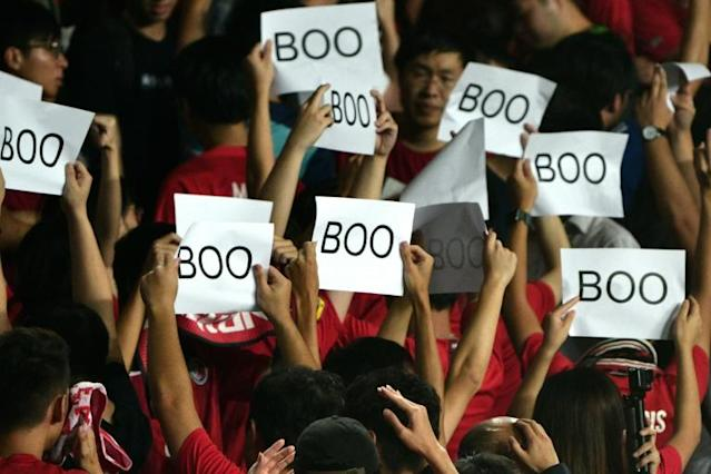 Hong Kong's football body has been fined after fans turned their backs and booed during the Chinese anthem at the start of a World Cup qualifying football match against Iran (AFP Photo/Anthony WALLACE)