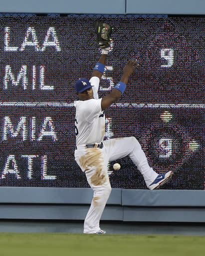 Los Angeles Dodgers right fielder Yasiel Puig misses a ball hit by San Diego Padres' Rene Rivera during the fourth inning of a baseball game on Saturday, Aug. 31, 2013, in Los Angeles. (AP Photo/Jae C. Hong)