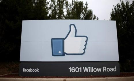 """The Facebook """"like"""" symbol at the company's headquarters in Menlo Park, Calif.: The social network is reportedly testing a new button that would appear on websites for retailers like Pottery Barn, giving users the option to """"want"""" items and make them show up on their News Feed."""