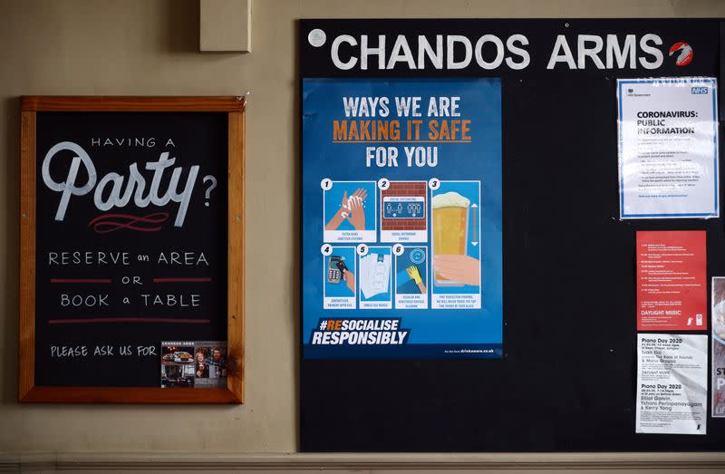 A safety sign is seen on a notice board in the Chandos Arms pub ahead of pubs reopening following the coronavirus disease (COVID-19) outbreak, in London