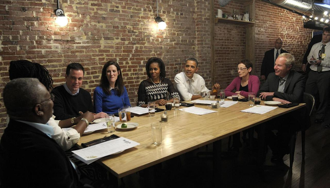 President Barack Obama and first lady Michelle Obama have dinner with grassroots supporters at Boundary Road Restaurant in Washington, from left, Robert Newkirk, Sr., a professor at Tennessee State University from Nashville, Regina Newkirk, a non-profit executive from Nashville, John Loringer, an attorney from Wauwatosa, Wis., Cathleen Loringer, a former social worker from Wauwatosa, Wis., Judy Glassman, a retired school administrator from Cambridge, Mass., and Mitch Glassman, an artist from Cambridge, Mass., Thursday, March 8, 2012. (AP Photo/Susan Walsh)
