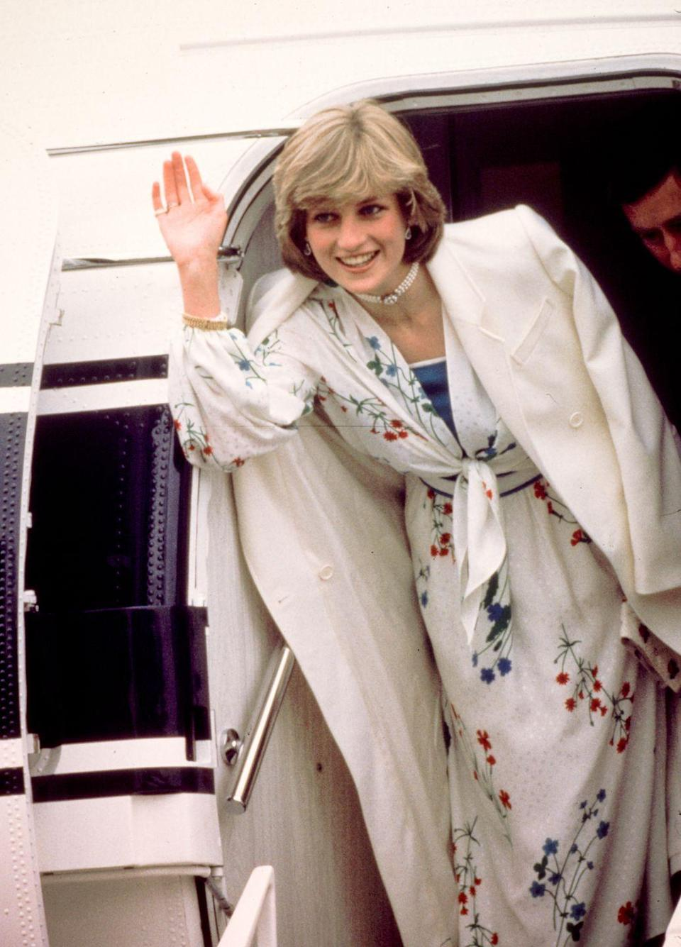 <p>Princess Diana looked chic in a Donald Campbell dress, long blazer and pearl choker when she and Prince Charles left for their honeymoon in August 1981. </p>