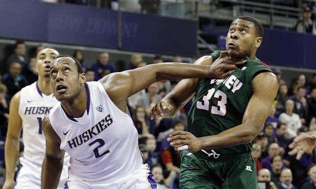 Washington forward Perris Blackwell (2) pushes against Mississippi Valley State forward Daniel Hurtt (33) as they move into rebounding position in the first half of an NCAA men's basketball game, Friday, Dec. 27, 2013, in Seattle. (AP Photo/Elaine Thompson)