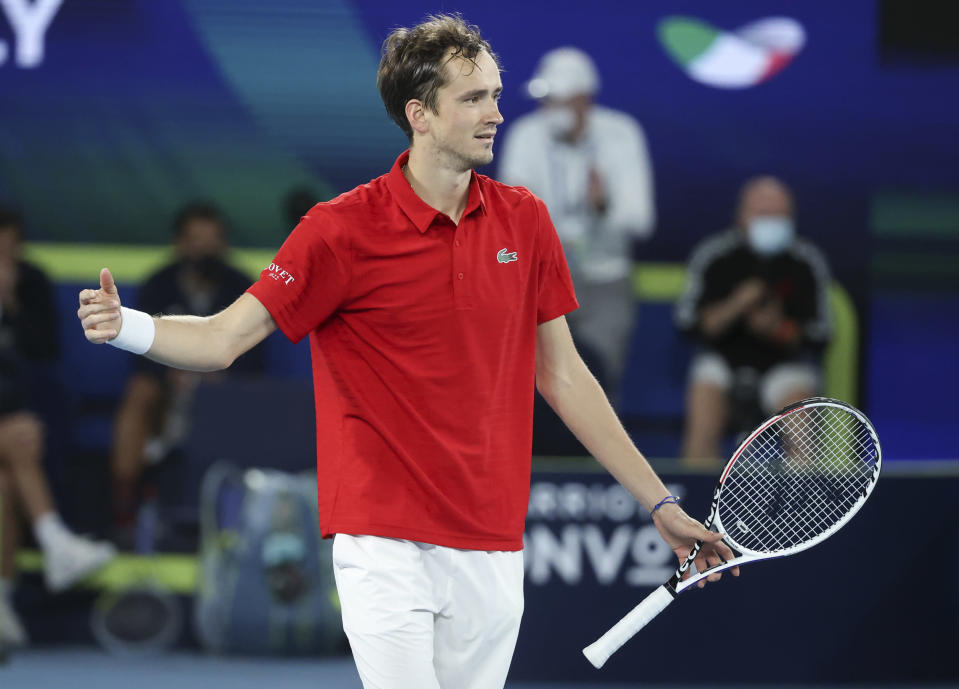 Russia's Daniil Medvedev celebrates after defeating Italy's Matteo Berrettini in the ATP Cup final in Melbourne, Australia, Sunday, Feb. 7, 2021.(AP Photo/Hamish Blair)