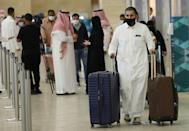 Saudi passengers arrive at the King Khalid International Airport in the capital Riyadh on May 17, 2021, as Saudi authorities lift travel restrictions for citizens immunised against Covid-19