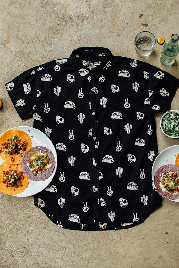 """<a href=""""https://www.etsy.com/listing/540802422/no-problemo-button-up-casual-button-up?ga_order=most_relevant&ga_search_type=all&ga_view_type=gallery&ga_search_query=tacos&ref=sr_gallery_17"""" target=""""_blank"""">Shop it here</a>."""
