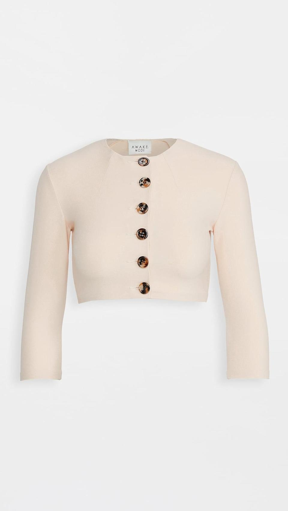 <p>This <span>A.W.A.K.E MODE Button Front Crop Top</span> ($215) is stunning.</p>