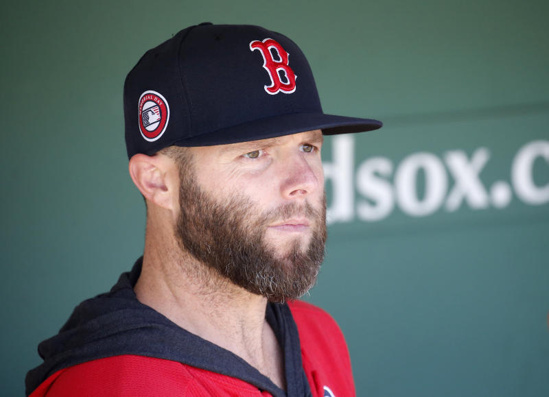 Boston Red Sox player Dustin Pedroia looks out from the dugout before the start of a baseball game against the Cleveland Indians, Monday, May 27, 2019, in Boston. (AP Photo/Mary Schwalm)