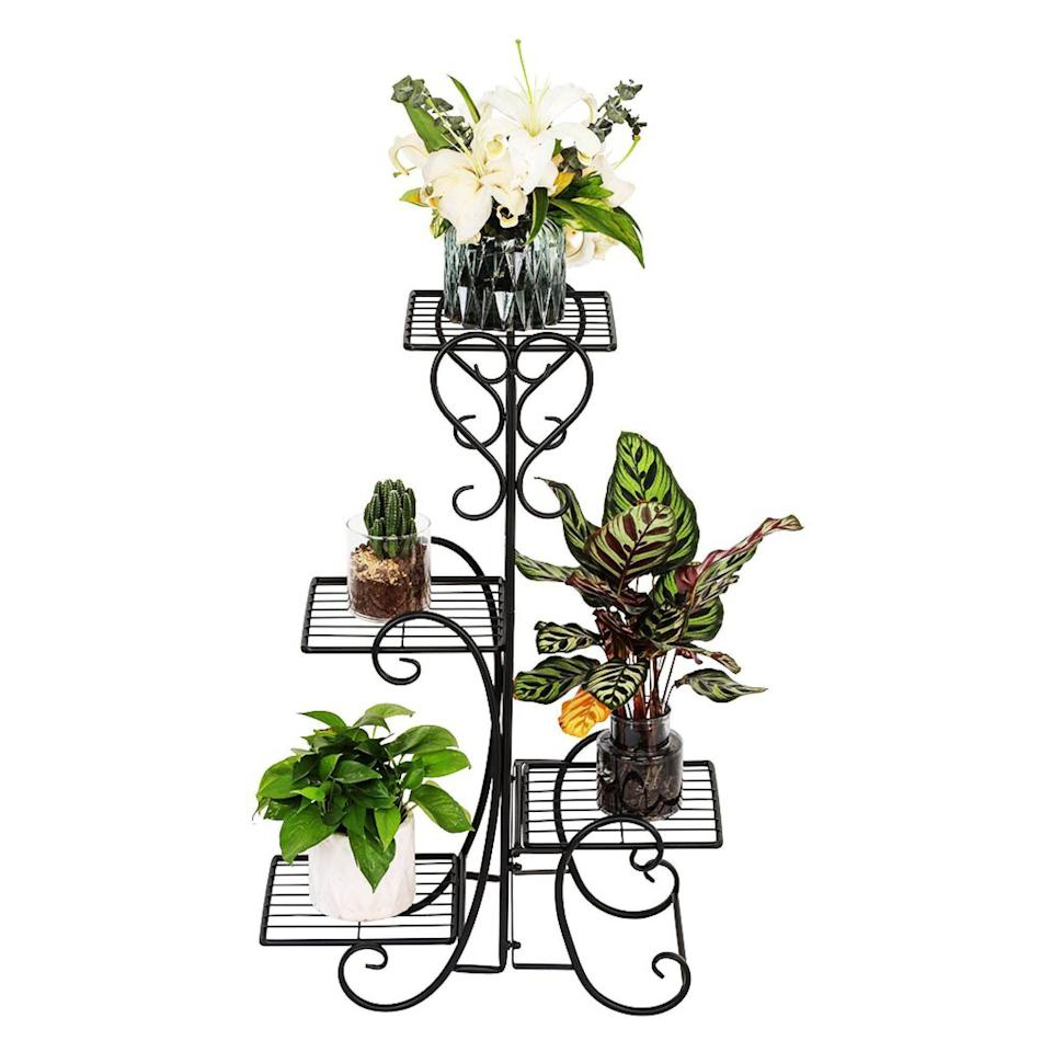 """<p><strong>Fleur De Lis Living</strong></p><p>wayfair.com</p><p><strong>$44.99</strong></p><p><a href=""""https://go.redirectingat.com?id=74968X1596630&url=https%3A%2F%2Fwww.wayfair.com%2Ffurniture%2Fpdp%2Ffleur-de-lis-living-deloris-square-multi-tiered-plan-stand-w000783028.html&sref=https%3A%2F%2Fwww.popularmechanics.com%2Fhome%2Fg36421088%2Fbest-plant-stands%2F"""" rel=""""nofollow noopener"""" target=""""_blank"""" data-ylk=""""slk:Shop Now"""" class=""""link rapid-noclick-resp"""">Shop Now</a></p><p>For something with charming country flair, this wrought-iron plant stand will showcase four of your favorite plants on its shelves. The piece is accented with decorative scrollwork, with metal fashioned in hearts and whimsical curves. The plant stand features a weather-resistant black powder-coated finish and stands just over 3 feet high. Each shelf has grilles to promote airflow beneath pots and is roughly 9 inches wide and deep. </p>"""