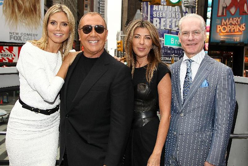 "Heidi Klum, from left, designer Michael Kors, Nina Garcia and Tim Gunn pose for photos while promoting the launch of the new season of ""Project Runway"" in New York's Times Square on Thursday, July 19, 2012. The fashion competition series, now in it's tenth season, premieres Thursday at 9 p.m. EST on Lifetime. (Photo by Donald Traill/Invision/AP)"