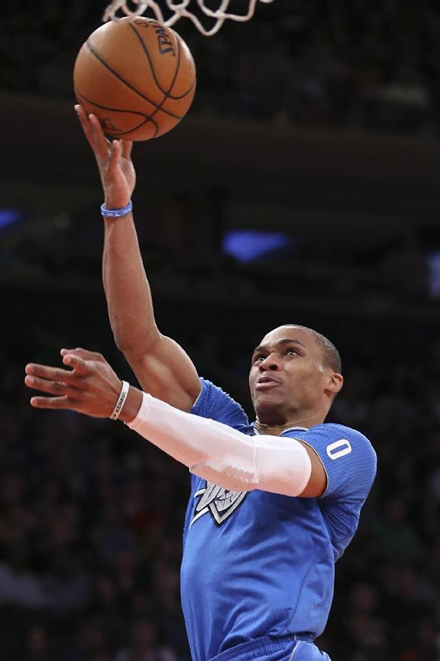 Oklahoma City Thunder guard Russell Westbrook shoots during the second half of the Thunder's NBA basketball game against the New York Knicks at Madison Square Garden, Wednesday, Dec. 25, 2013, in New York. The Thunder won 123-94. (AP Photo/John Minchillo)