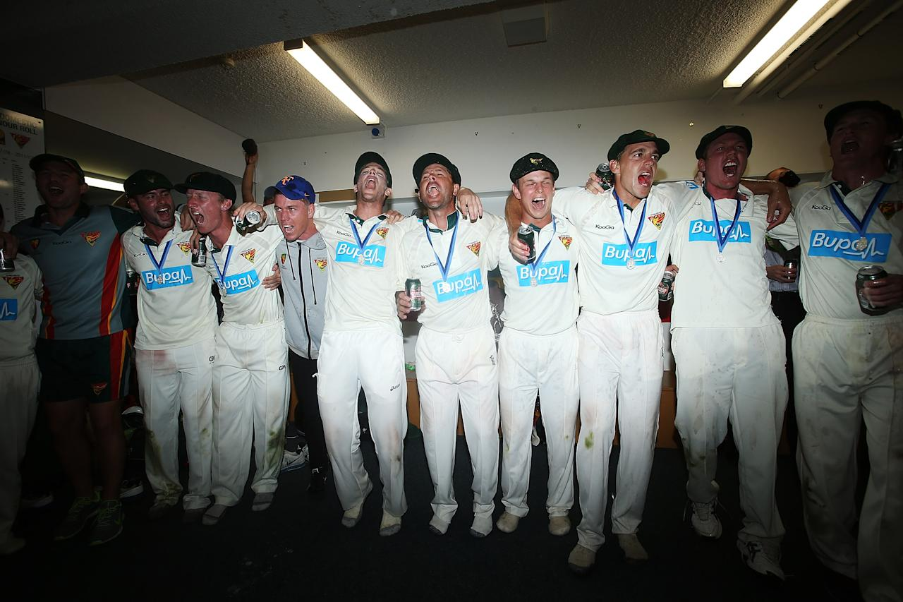HOBART, AUSTRALIA - MARCH 26: Tigers players celebrate in the changing rooms after winning the Sheffield Shield final between the Tasmania Tigers and the Queensland Bulls at Blundstone Arena on March 26, 2013 in Hobart, Australia.  (Photo by Mark Metcalfe/Getty Images)